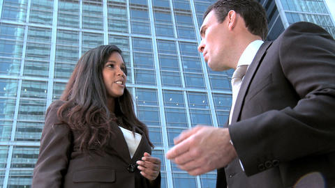 Smart young business people meeting outside modern workplace Stock Video Footage