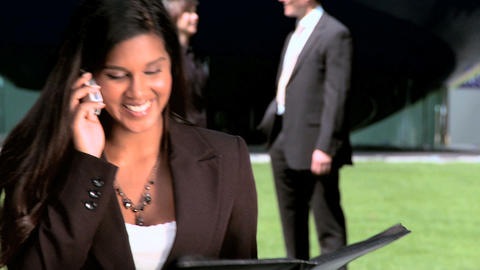Young city business woman,with colleagues,talking on... Stock Video Footage