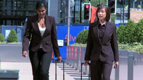 Smart young city business women preparing to travel from city airport Footage