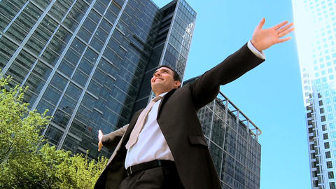 Successful young city businessman celebrating achieving... Stock Video Footage