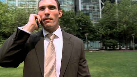 Smart young city business man talking on mobile(cell)... Stock Video Footage