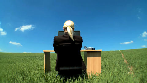 Young businesswoman in conceptual office w/out walls showing excitement for the future Footage
