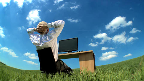 Businessman in conceptual office w/out walls daydreaming... Stock Video Footage