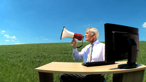 Businessman in concept office shouting his message to the world Footage