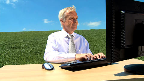 Businessman in city clothes working in conceptual office w/out walls Footage
