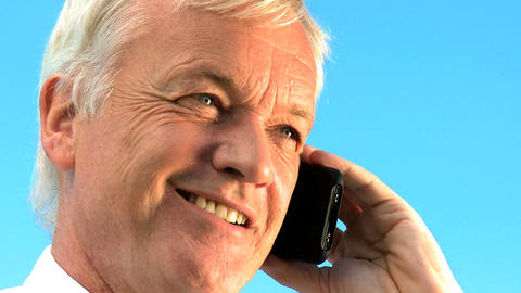 Portrait Of Mature Businessman Talking Outdoors On A Mobile(cell) Phone stock footage