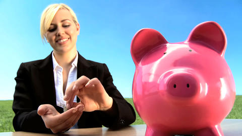 Businesswoman using money pig for green investment in an environmental future Footage