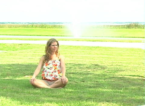 Beautiful Blonde Meditatiing Outdoors-2 Stock Video Footage