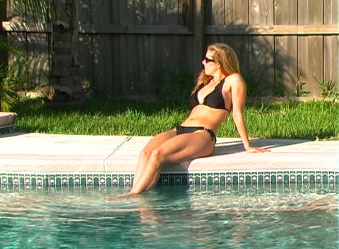 Beautiful Blonde in a Black Bikini Poolside-1b Footage