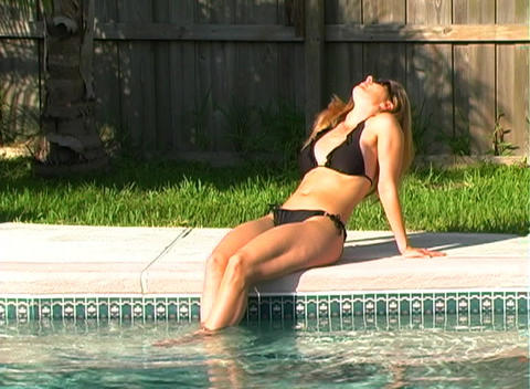 Beautiful Blonde in a Black Bikini Poolside-1b Stock Video Footage
