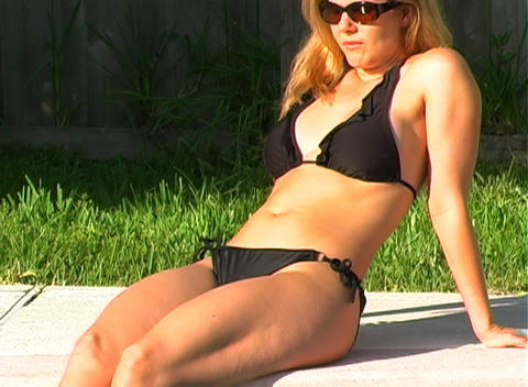 Beautiful Blonde in a Black Bikini Poolside-3 Footage