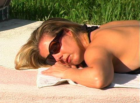 Beautiful Blonde in a Black Bikini Poolside-5 Stock Video Footage