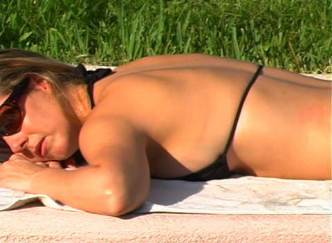 Beautiful Blonde in a Black Bikini Poolside-5 Footage