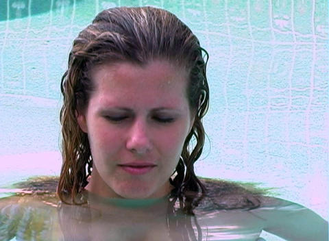Beautiful Blonde in a Swimming Pool (close-up) Live Action
