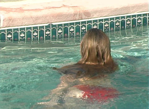 Bikini-clad Blonde Dives into a Swimming Pool-2 Stock Video Footage