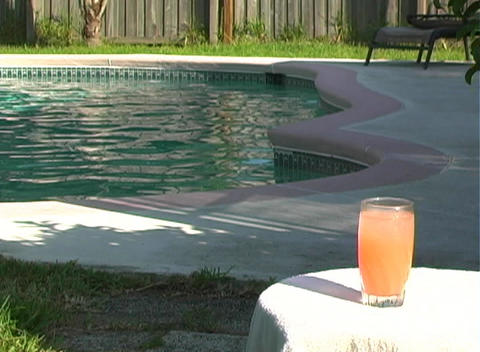 Drink at the Pool with a Bikini-clad Blonde Stock Video Footage