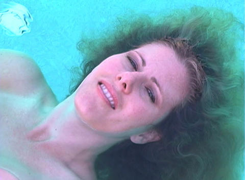 Beautiful Blonde Floating in a Pool-1 Footage