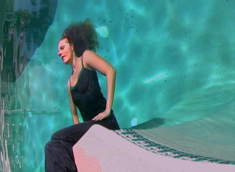 Beautiful Blonde Sits in a Wall of Water-3 Stock Video Footage