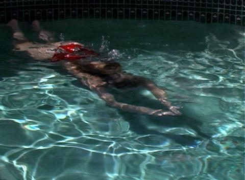 Sexy, Bikini-clad Blonde in a Swimming Pool-1 Stock Video Footage