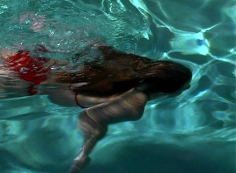 Sexy, Bikini-clad Blonde in a Swimming Pool-1 Stock Video Footage