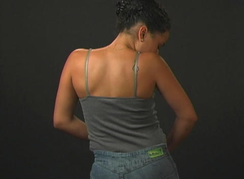 Putting on Her Jeans - Rear View Stock Video Footage