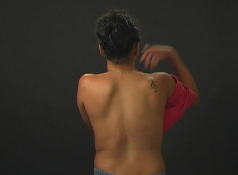 Putting on Her T-shirt (1) Stock Video Footage