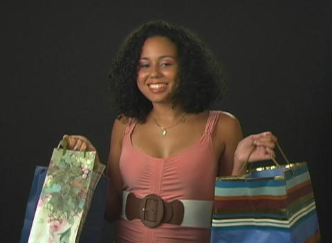 Beautiful Young Woman with Shopping Bags Stock Video Footage