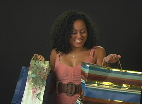 Beautiful Young Woman with Shopping Bags Footage