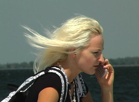 Beautiful Blonde with Cell Phone Outdoors Stock Video Footage