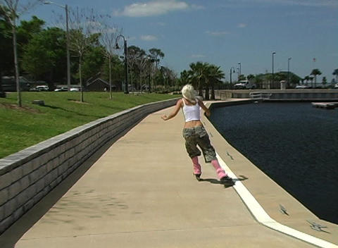 Beautiful Blonde Rollerblading Outdoors Stock Video Footage