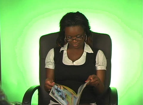 Beautiful Young Businesswoman Reads a Magazine Stock Video Footage