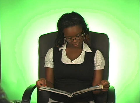 Beautiful Young Businesswoman Reads a Magazine Footage