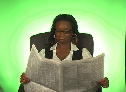 Beautiful Businesswoman Reads a Newspaper Stock Video Footage