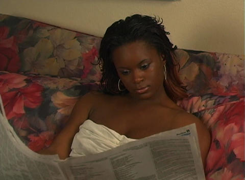 Beautiful Woman in Bed Reading a Newspaper-1b Footage
