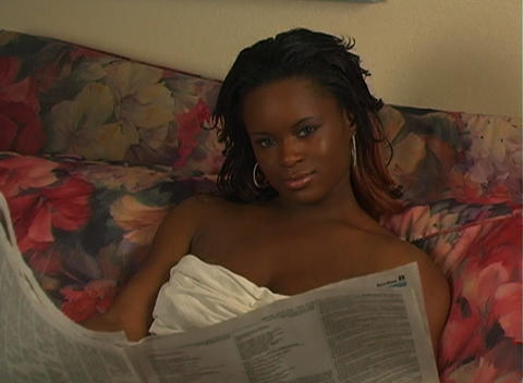 Beautiful Woman in Bed Reading a Newspaper-1b Stock Video Footage