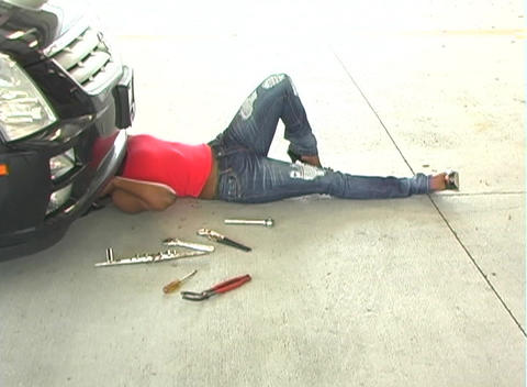 Sexy Female Mechanic in a Hot Pair of Jeans Stock Video Footage