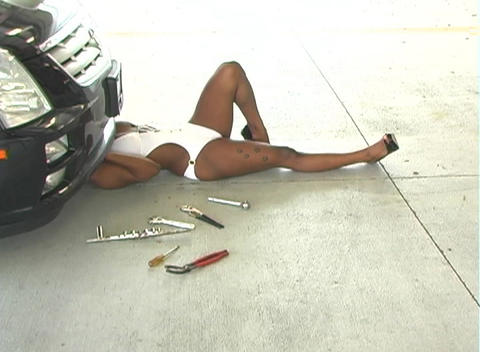 Sexy Female Mechanic in a Hot Swimsuit Stock Video Footage