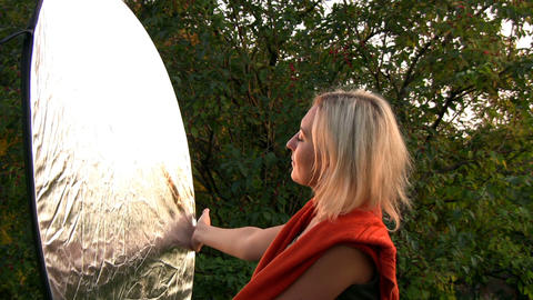 Playing with light reflector Stock Video Footage