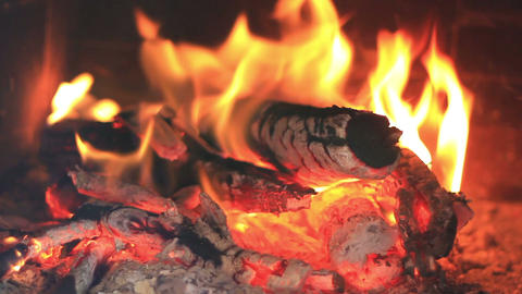 Fireplace full fire and woods Footage