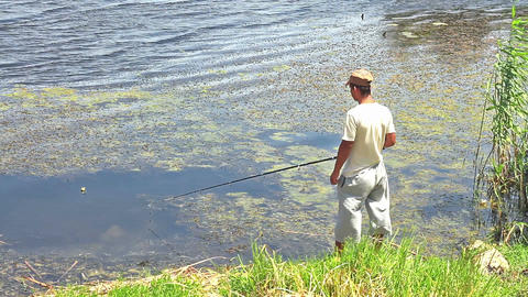 Fisherman Near Pond stock footage