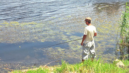 Fisherman near pond Stock Video Footage