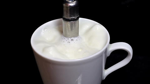 Boiling milk in a coffee express Stock Video Footage