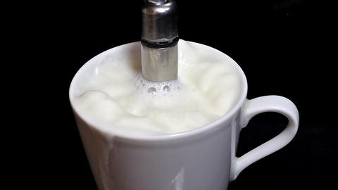 Boiling Milk In A Coffee Express stock footage