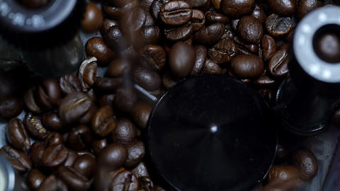 Pouring coffee beans into the grinder Stock Video Footage
