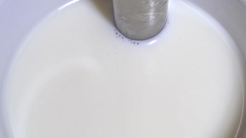 Heating milk - top view Stock Video Footage