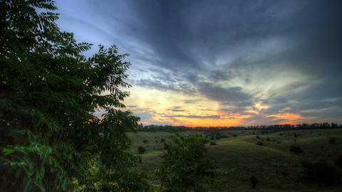 Timelapse Spring Sunset Over Meadow Stock Video Footage
