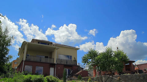 Clouds over modern house timelapse Stock Video Footage