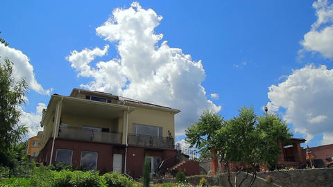 Clouds over modern house timelapse Footage