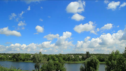 White clouds and blue sky over the river timelapse Stock Video Footage