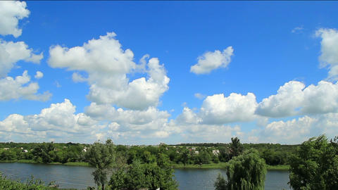 White Clouds And Blue Sky Over The River Timelapse stock footage